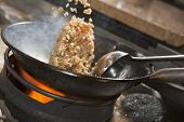 image of chinese wok  - Closeup of fried rice being cooked in wok - JPG