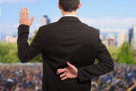 image of politician  - Politician swearing an oath with fingers crossed behind back - JPG