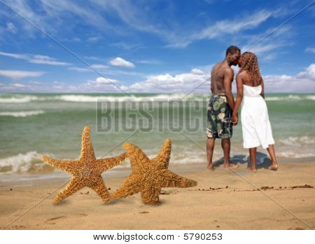 Romantic Couple Walking Into The Surf
