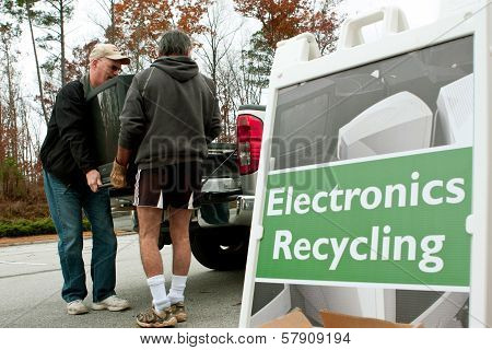 Men Carry TV To Drop Off At Recycling Event