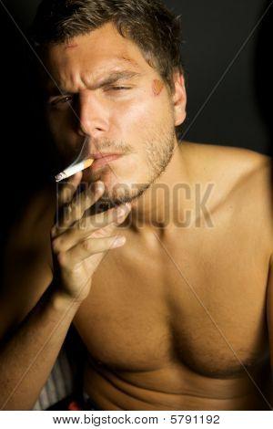 Young Sexy Man Smoking A Cigarette