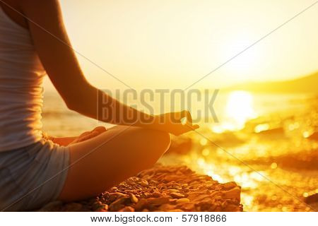 Hand Of  Woman Meditating In A Yoga Pose On Beach