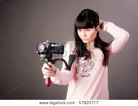 young woman with video camera