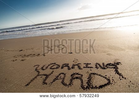Sand Script With Ocean At Background