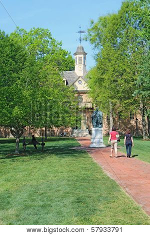 Tourists Walk Towards The Wren Building On The William And Mary Campus