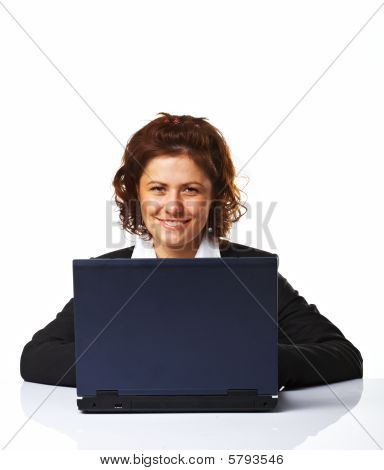 Portrait Of A Business Woman Working On A Laptop