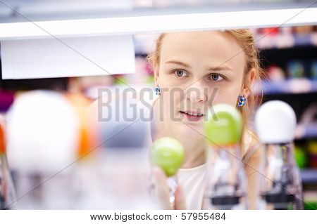 Young woman analyzing products in a store