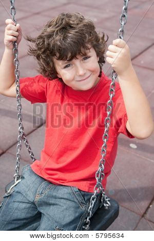 Happy Child On The Swing