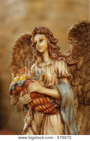 Picture or Photo of Angel carrying a basket of fruits