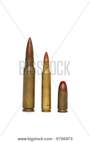 Three red-tipped tracer cartridges of various calibers isolated