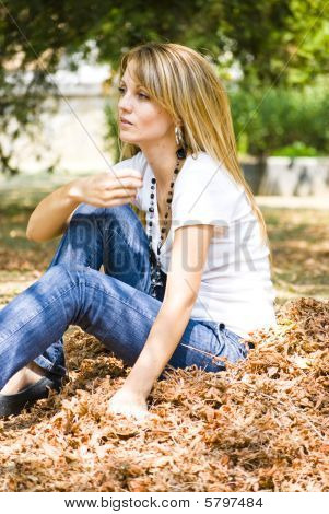 Beautiful Young Woman Throwing Leaves