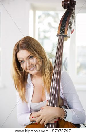 Woman Hold On Contrabass With Both Hands