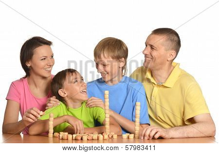 Happy family playing lotto
