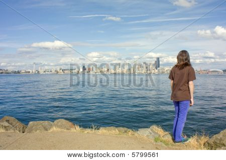 Seattle Space Needle And Skyline With Young Girl Looking