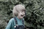 image of child abuse  - Crying child boy on the grass summer outdoors - JPG
