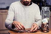 image of goatee  - Man is Counting His Money In the Kitchen - JPG
