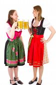 Women In Dirndls Clinking Their Beersteins
