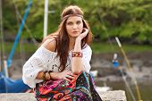 stock photo of outfits  - Pretty young hippie caucasian girl in motley boho fashion style outfit - JPG