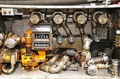stock photo of tank truck  - Valving and meter area of a fuel pump station and valving on a local delivery MC 306 - JPG