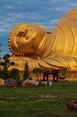 pic of recliner  - Close up Reclining Buddha with blue sky