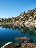 image of ou  - Beautiful high mountains lake with water reflection Gourget de Madamet ou gourg de Rabas in Neouvielle natural reserve - JPG