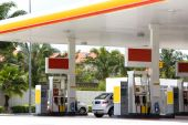 picture of gasoline station  - Image of a gas station with cars being refulled.
