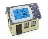 picture of humidity  - one digital programmable thermostat with a house and solar panel concept of renewable energy  - JPG
