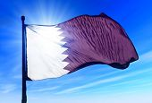 foto of qatar  - Qatar flag waving on the wind on the sky - JPG