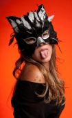 image of catwomen  - Young caucasian girl wearing a cat mask - JPG