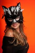 stock photo of catwomen  - Young caucasian girl wearing a cat mask - JPG