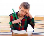 stock photo of dyslexia  - Frustrated woeful student because of learning difficulties - JPG