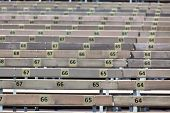 stock photo of grandstand  - Wooden Grandstand Seats with Numbers. Horizontal shot