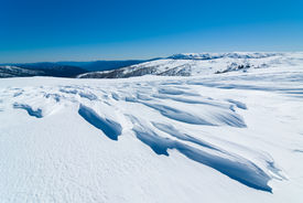 stock photo of bogong  - Windswept snow and view to Mt Bogong from above Falls Creek - JPG