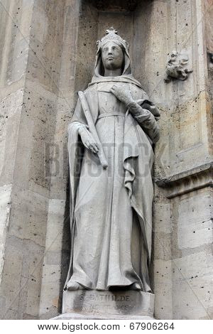 PARIS, FRANCE - NOV 11, 2012: Saint Bathilde statue, Church of St-Germain-l'Auxerrois founded in the 7th century, was rebuilt many times over several centuries.