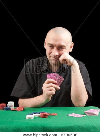 Poker Gambler In Black Shirt In Casino.