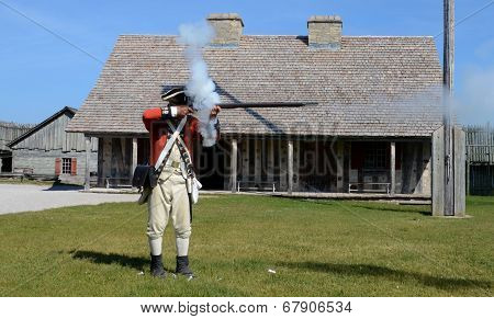 Re-enactor Fires Musket At Fort Michilimackinac