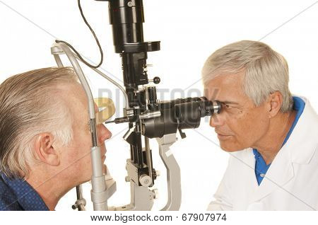 Optician, Optometrist or Ophthalmologist checking patient's eyes, isolated on white