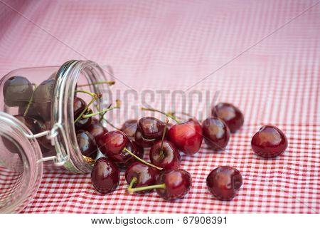 Glass Storage Jar Full Of Fresh Cherries