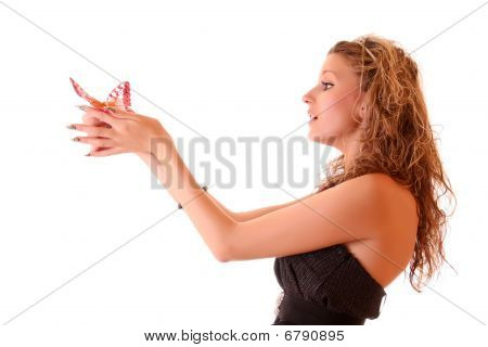 Portrait Of Beautiful Girl In  Black Dress And In A Diadem And Holds Red Butterfly In The Hands  Iso