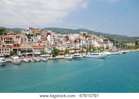 SKIATHOS, GREECE - JUNE 14, 2013: Boats moored in the harbour at Skiathos Town on the Greek island of Skiathos. The harbour was one of the locations for the 2008 film Mamma Mia.