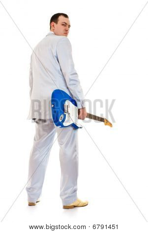 Man In White Suit With Electric Guitar Look Back