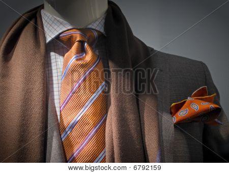 Grey Jacket With Brown Scarf, Orange Tie And Handkerchief