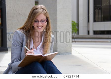 Happy Woman Writing In Her Journal
