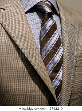 Light Grey Checkered Jacket, Blue Shirt And Tie