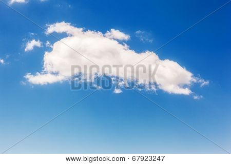White fluffy clouds in the fantastic blue sky.