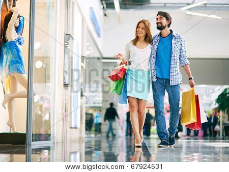 Portrait of young couple shopping in the mall