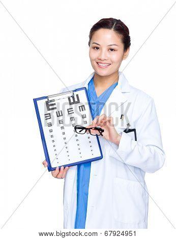 Female optician doctor showing eye chart