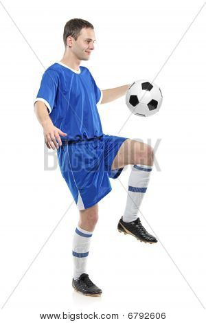 Soccer player with a ball