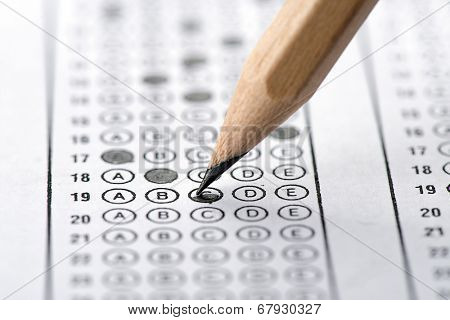 Filling answers of multiple choice examination close up