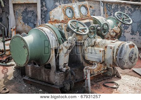 Rusted Bow Anchor Winch On Abandoned Ship